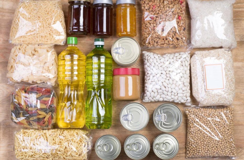 Food bank donations organized on a wood table